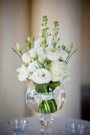 white rose and ranunculus wedding centerpiece
