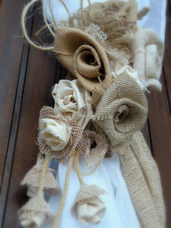I would love to know how to make this!!! This listing is for one burlap tie back, with few burlap flowers of varying sizes on wide burlap ties. The back of the flowers is pinned on burlap