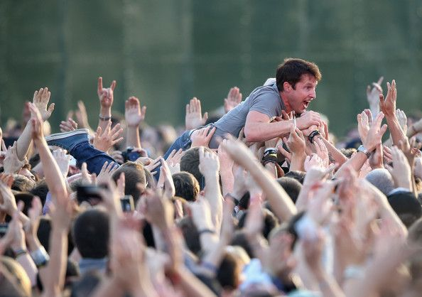 James Blunt Photos Photos - Singer James Blunt crowd surfs at the Invictus Games Closing Ceremony during the Invictus Games at Queen Elizabeth park on September 14, 2014 in London, England. The International sports event for 'wounded warriors', presented by Jaguar Land Rover was an idea developed by Prince Harry after he visited the Warrior Games in Colorado USA. The four day event has brought together thirteen teams from around the world to compete in nine events such as wheelchair…