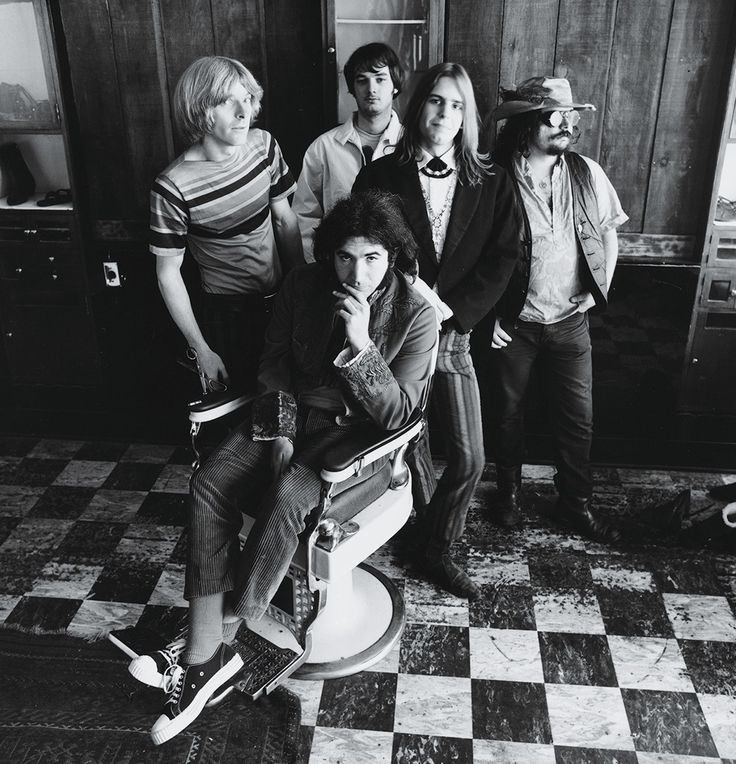 "The Grateful Dead at a Haight Street barbershop, in San Francisco, 1967: Phil Lesh, Jerry Garcia (seated), Bill Kreutzmann, Bob Weir, and Ron ""Pigpen"" McKernan. By Herb Greene."