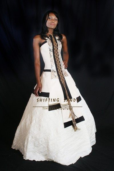Shifting Sands Traditional African Xhosa inspired baige and black wedding dress with leather and feather detail