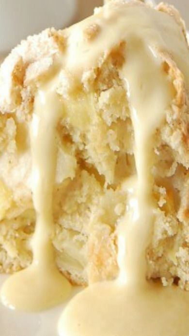 Irish Apple Cake with Custard Sauce ~ The cake is excellent all on it's own, but what really turns it into a decadent dessert is the custard sauce. Poured warm over the top of a slice of apple cake, its creamy sweetness is the perfect addition to the thick fruit filled cake.