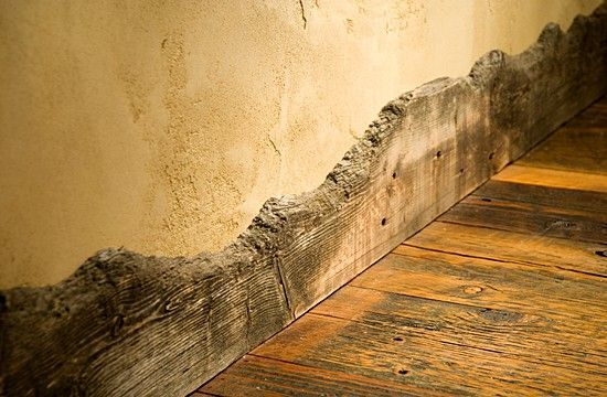 Wood baseboards from an old corral