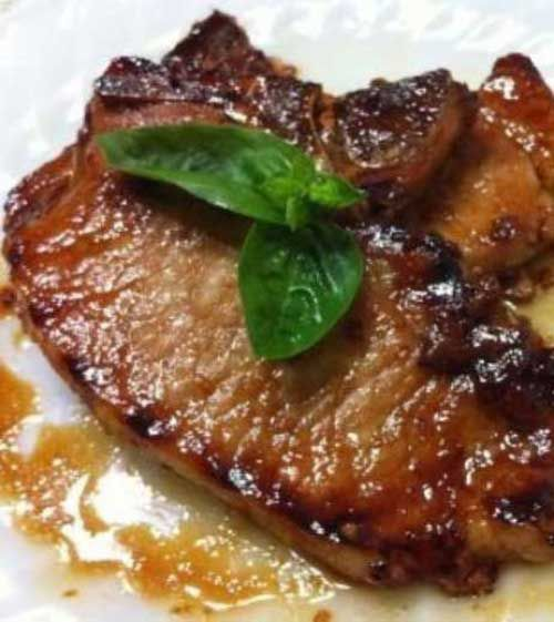 Recipe for Honey Garlic Pork Chops - You'll love the robust taste of these tender chops. The honey and garlic sauce is so good, I sometimes double it so there's extra for dipping.
