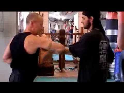 Nottingham Foshan Wing Chun. Dan Chi Sau Variation. Instructor is indicating how to respond to thwarted attack by sense of feel