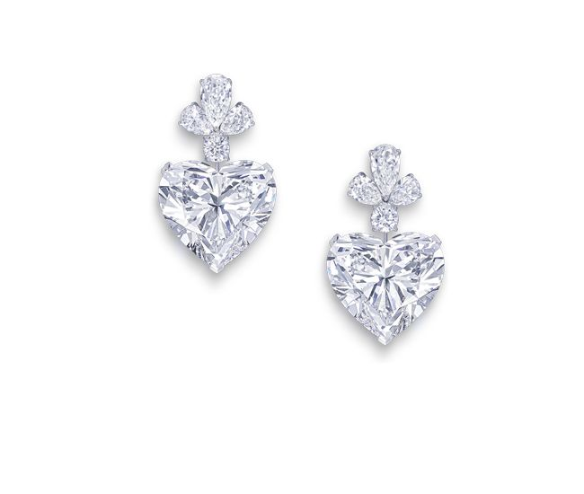 The Graff Sweethearts 51.53ct D Flawless and 50.76ct D Flawless heart shaped diamonds, set as earrings.