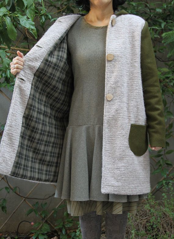 Off white wool coat with olive green sleeves and olive wood buttons, by EatingTheGoober