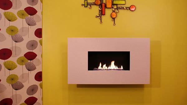 The SLEEK flueless gas fire has been designed with a low profile for use in modern homes. The fascia size is 645mm x 1140mm and is available in either Beige Marfil stone or Black Steel. This modern gas fire requires no chimney and is 100% energy efficient.