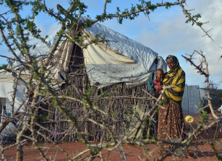A Somali refugee woman with her child at Kenya's Dadaab refugee camp