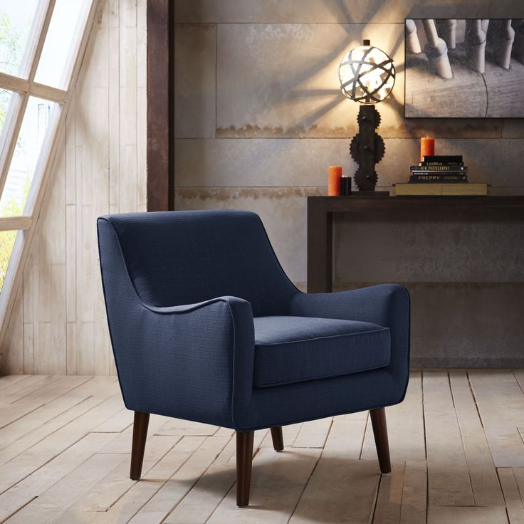Give your room a classy accent with the Oxford Oceanside chair. You'll love the espresso finished legs and the ready for Madison Avenue styling of this mid-century modern chair.