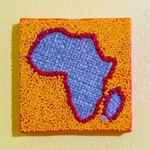 Shop: Canvas D'Afrique - Orange is the new Africa. This Africa is partially beaded on canvas in light orange and red with a center of a blue textue. Size: 10cm x 10cm. By Beadoir D'Afrique