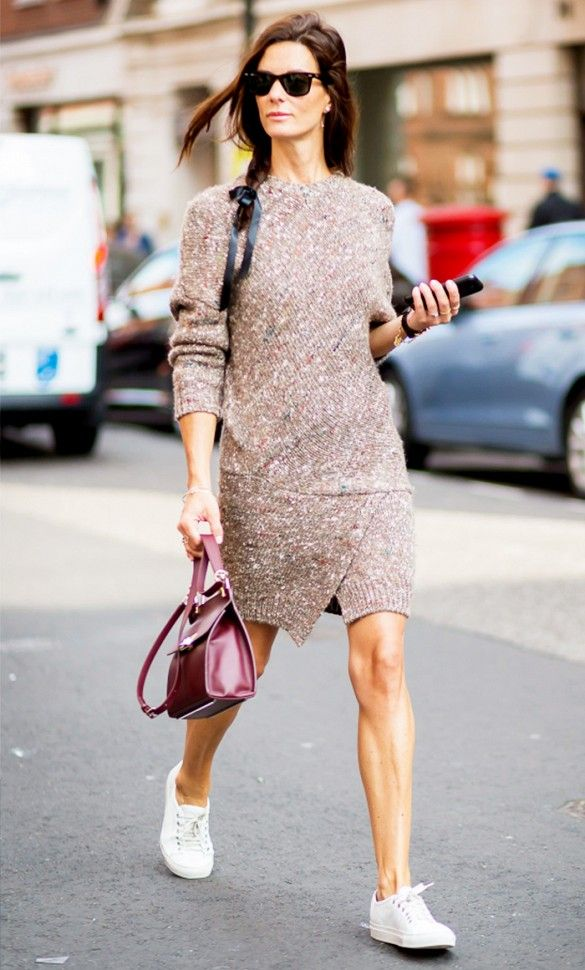 Pair a sweater dress with a top-handle bag and clean white sneakers for a stylish, sporty ensemble.