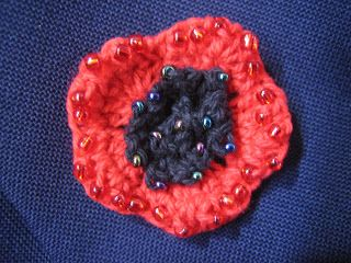 crochetroo: ANZAC Poppy - free crochet pattern This pretty little poppy is embellished with beads and worn as a brooch.