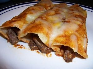 Mexican Style Carne Asada ( Steak ) Enchiladas in Red Sauce