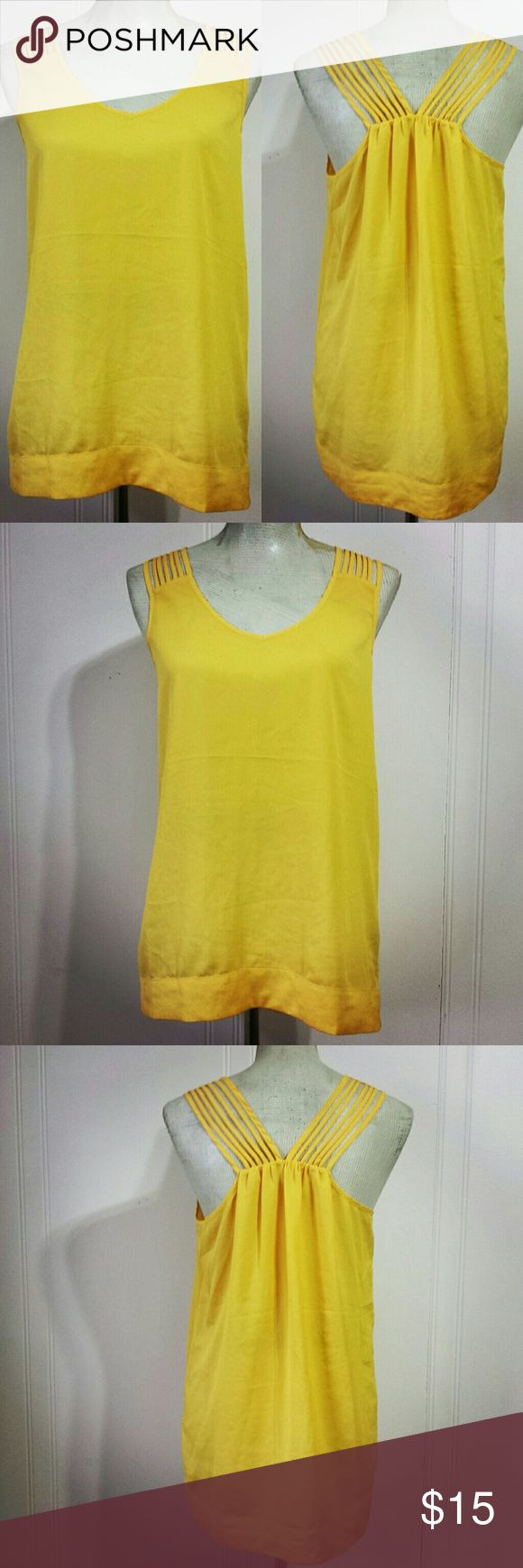 Naked Zebra Yellow Lightweight Tank Top There is no reason you can't have fun and be comfy at the same time. This funky yellow tank top can help you get there. This shirt is made from a lightweight flowy polyester. This naked Zebra tank top is in excellent condition. Naked Zebra Tops Tank Tops