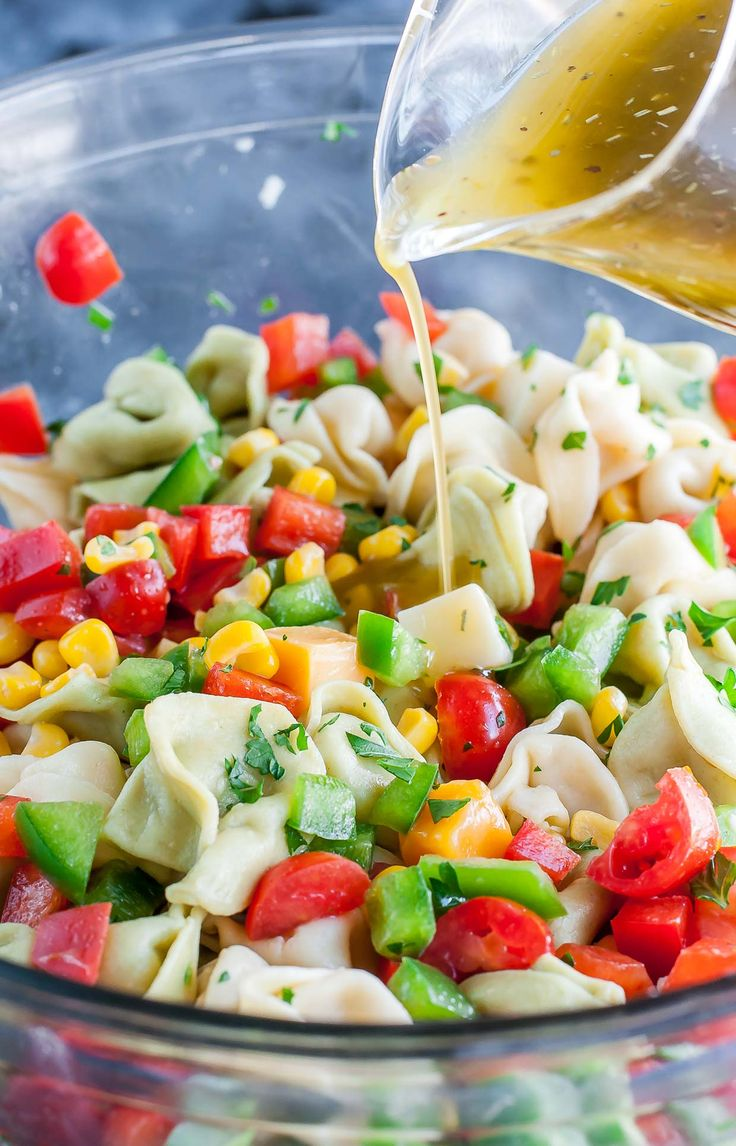 This easy vegetarian Garden Veggie Tortellini Pasta Salad is tossed with a flavorful homemade dressing and is sure to vanish quickly at your next party!
