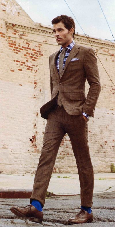 James Marsden. tweed suit. Swap blue socks for red argyle. and brown tie for something orange.