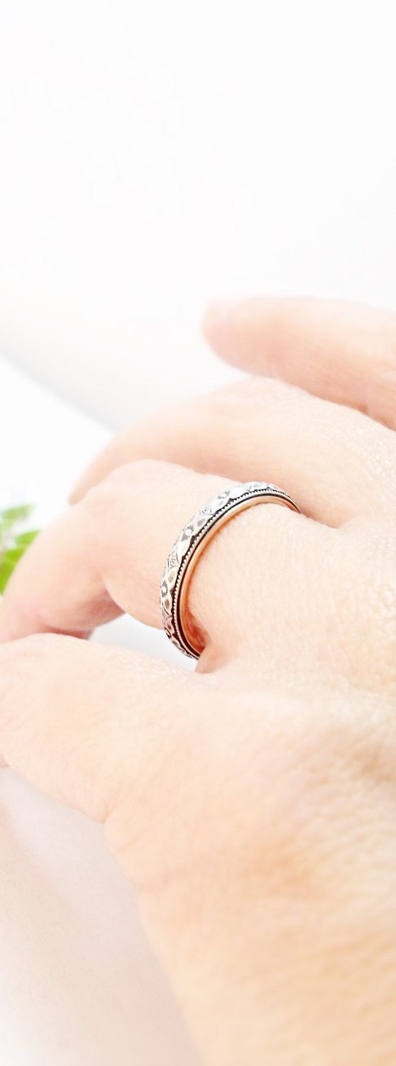 This delicate, skinny wedding band is just 3mm (1/8 inch) wide. It is made from sterling silver and 14k rose gold. It features a slightly domed, floral sterling silver band and is finished with a 14k rose gold lining for a smooth edge and a comfortable fit. Rose gold has a warm, coppery red tone that complements the darkened silver nicely. (Also available with either 14k yellow gold or 14k white gold lining. Please note your choice in the dropdown menu.) I can engrave this ring for a sma...