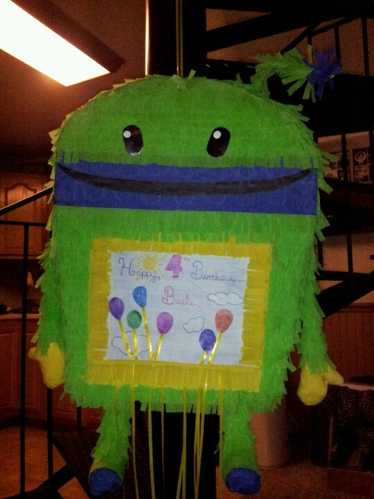 Bot pinata I made (Team Umi Zoomi)......cardboard, tape, glue, party streamers and ribbon....I had most of the stuff laying around the house. I spent $4 on party streamers @ the dollar store.