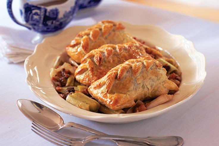Make sure everyone is happy at your next dinner party with these individual Beef Wellingtons in a rich bacon and port sauce.