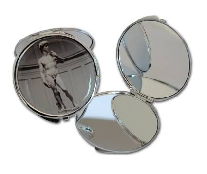 Round metal pocket mirror with top image of the David by Michelangelo. Accademia Gallery - Florence. 7 cm diameter. #firenzemuseistore #art #Michelangelo #David #Accademiagallery #Florence #accessories #pocketmirror