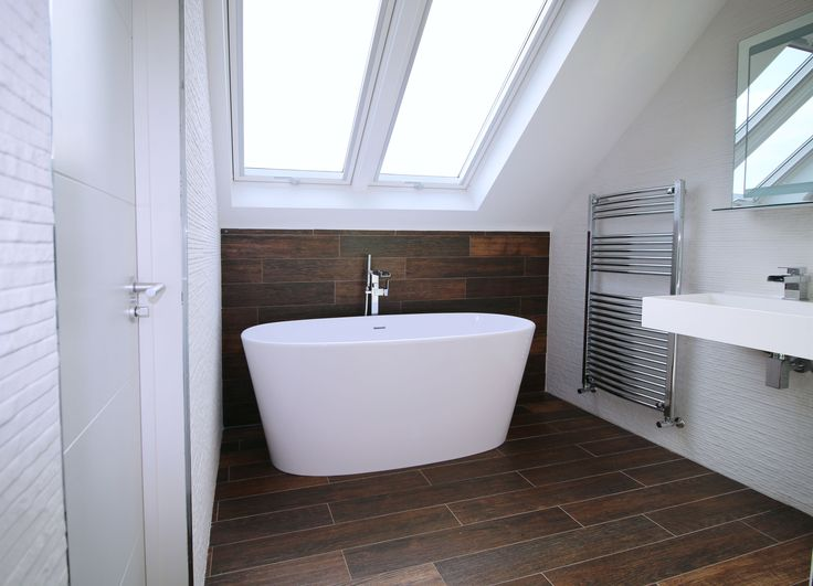 A finished loft conversion we provided a full Architectural service for in Napsbury Park. The loft has been converted to form a master bedroom, dressing room and ensuite bathroom