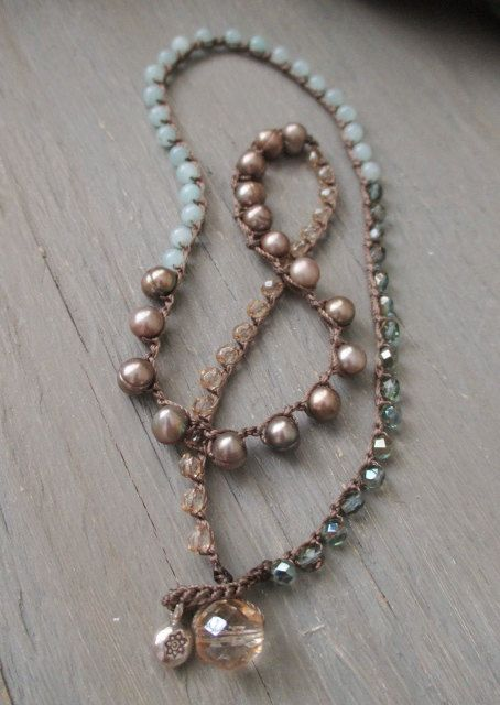 Neatly crocheted freshwater pearls, semi precious stones, and Czech glass in muted, natural beach tones. Wear as a necklace, double wrap for an