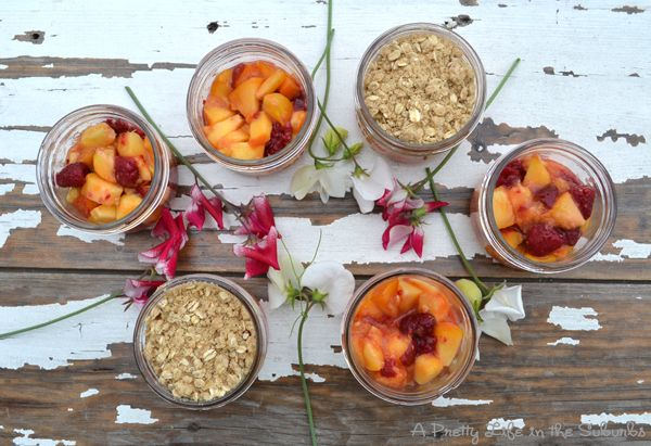 A Pretty Life in the Suburbs: Peach Raspberry Crisps in Mason Jars -- I LOVE peach crisp, and if I measured my ingredients, this is likely very close to the recipe I use.  This is cute and looks simple and yummy.. I'll have to try it once I get settled again.