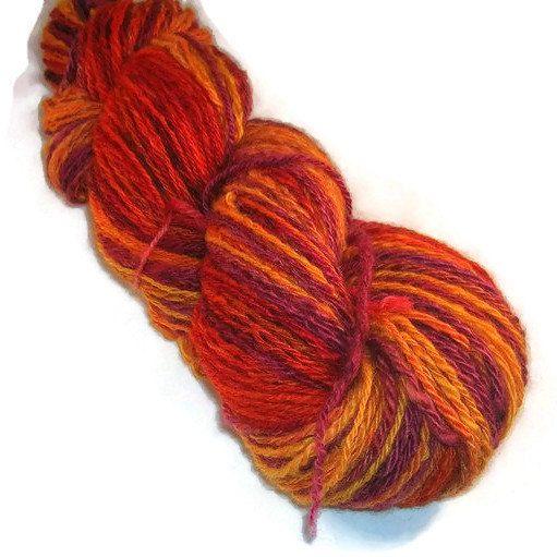 Handspun, hand dyed, worsted 3-ply self striping yarn.