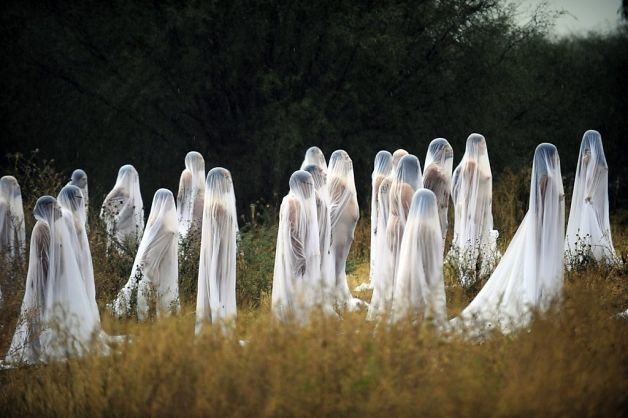 Ghosts of the Day of the Dead: Naked volunteers draped in sheer fabric pose for U.S. photographer and artist Spencer Tunick's group portrait at Los Senderos in Guanajuato state, Mexico. Tunick was in Mexico for one day to photograph a performance commemorating the Day of the Dead. Photo: Alfredo Estrella, AFP/Getty Images / SF
