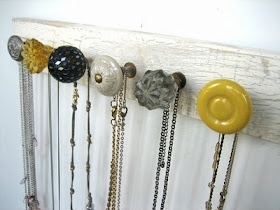 Cabinet knobs. Love this for jewelry and further apart for coats and purses. In thinking cute anthropologie hardware and driftwood...