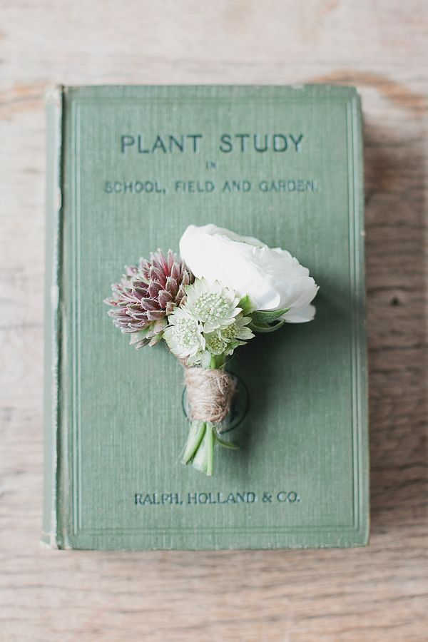 Beautiful flower/vintage book detail - great way to add detail and decor at a vintage inspired wedding.  Exquisite Original Vintage Wedding Dresses in the North East UK  Flowers http://www.darlingandgreen.co.uk/ Dresses http://www.vintageatnumber18.co.uk/ Photography http://www.evephotography.co.uk