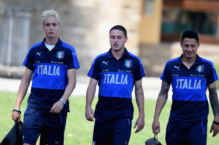 (L-R) Andrea Conti, Davide Calabria and Gianluca Lapadula of Italy look on during the training session at Coverciano at Coverciano on May 30, 2017 in Florence, Italy.