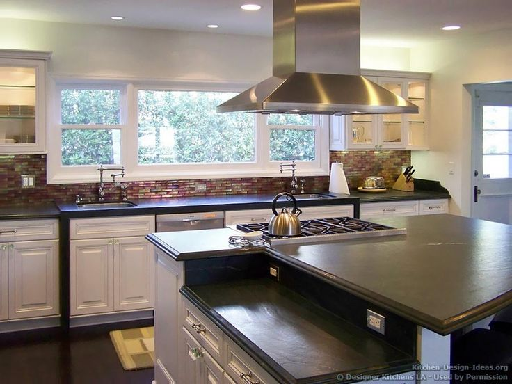 Luxury white kitchen with a bi level island and - Images of kitchen islands ...