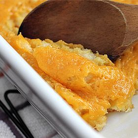 Paula Deen's Corn Casserole. 1 can corn, w can cream style corn, 1 pkg corn muffin mix, 1 cup sour cream, 1/2 stick butter, top with cheddar cheese