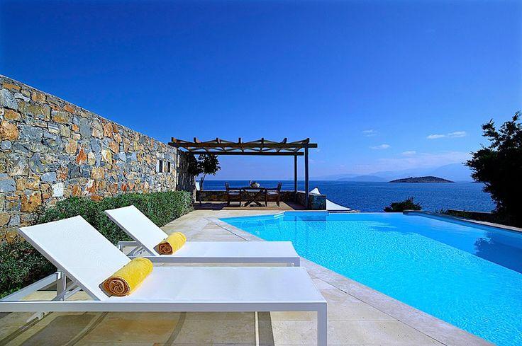 Helios Villa in Thalassa Villas Resort, Agios Nikolaos, Crete Island. Helios Villa combines perfectly seclusion and luxurious facilities and services in an exceptional location offering breathtaking views on Mirabello Bay. The spacious villa,
