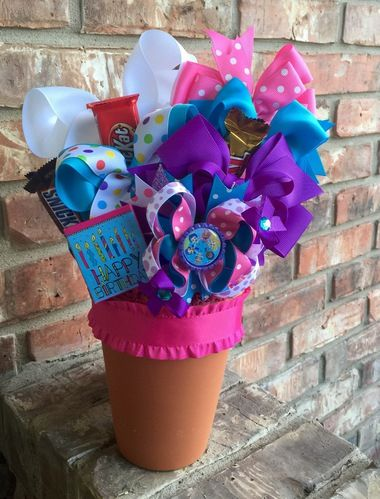 What little girl wouldn't want this SUPER CUTE Hair Bow Bouquet featuring their favorite character and tasty treats. Each hair bow bouquet is unique and both cute and functional. Surprise your little