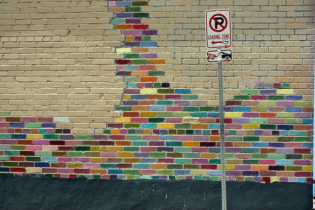 Rainbow painted brick wall -