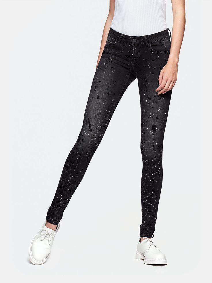 Skinny jeans met verf zwart