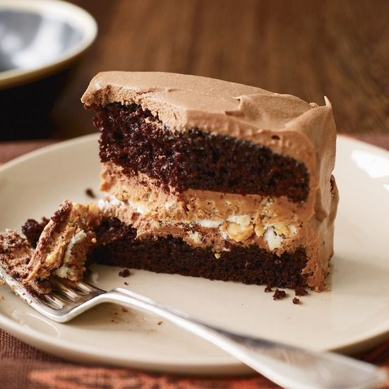 The genius of this layer cake is its extraordinarily crunchy filling, made with almonds, salted peanuts, creamy peanut butter, chocolate and Rice Krispies. The silky milk-chocolate ganache frosting almost pushes the recipe over the top.