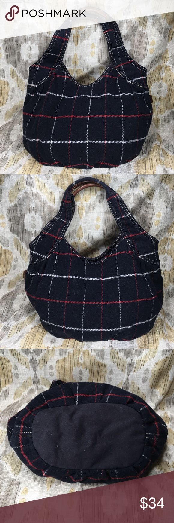 """American Eagle Outfitters Handbag Navy blue plaid. Handbag has zipper pocket on side wall. Opposite side wall is a double slit pockets. Double straps. No damage or stains in excellent condition. Measures 11""""H X 17.5""""W X 6""""W. Strap drop measures 11"""". Bags Hobos"""