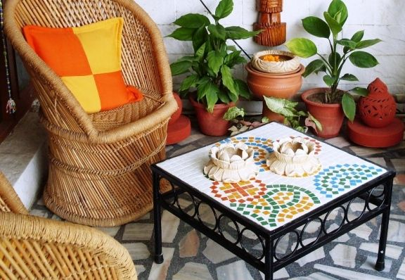 """some greens, terracotta, mosaics and bamboo furniture.. makes a perfect setting for some """"me"""" time or just any time."""
