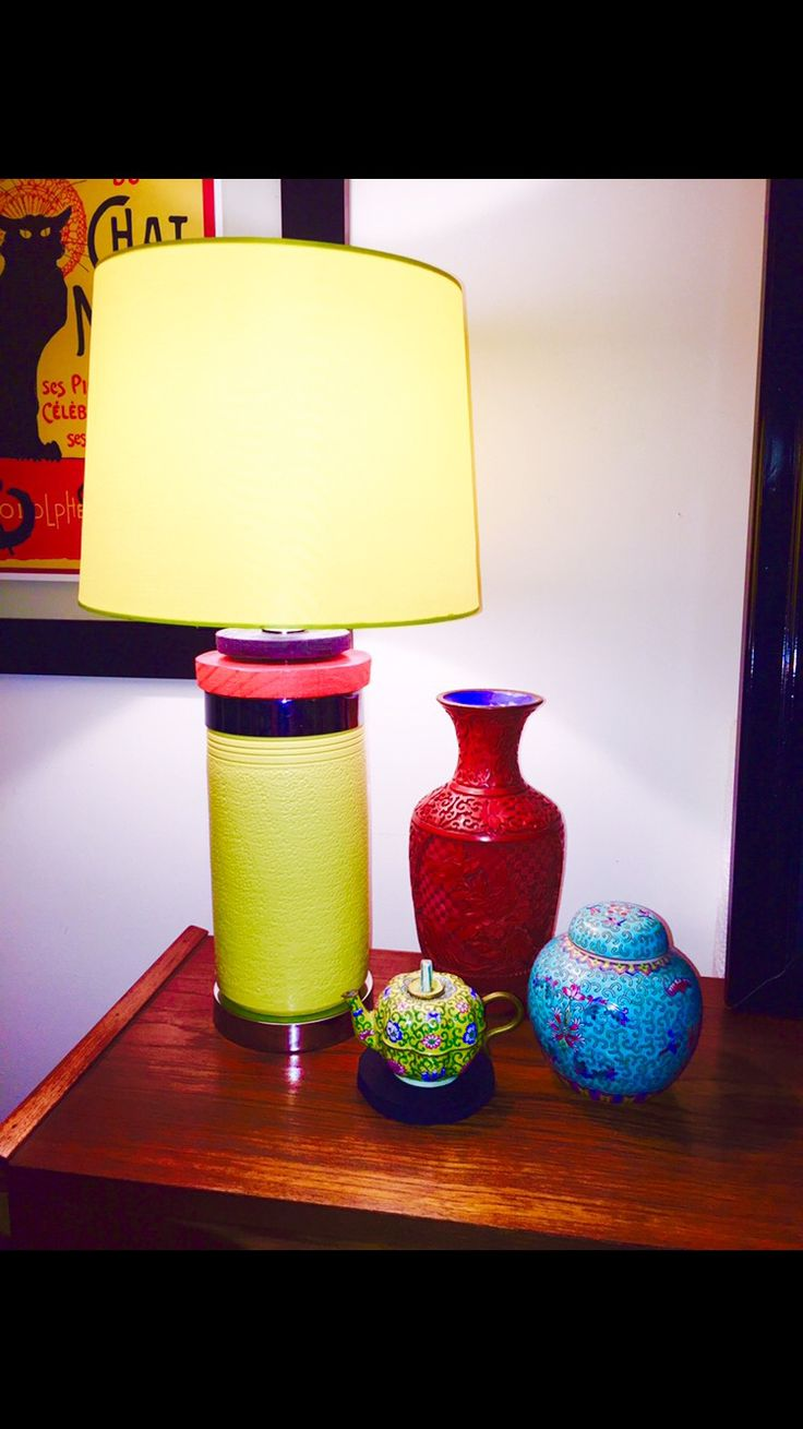 Lamp made from old yellow vase. Red and black discs made from reclaimed timber and chrome disc from other lamp parts.