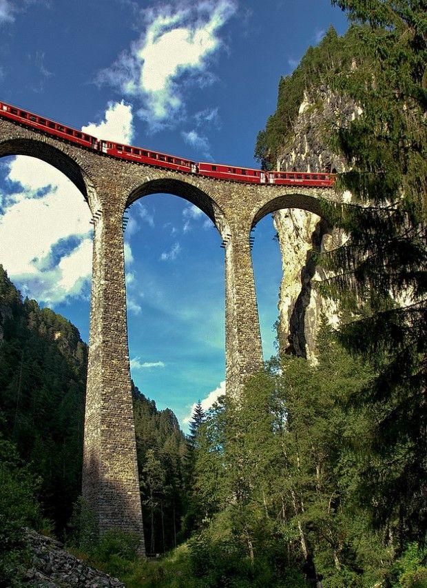 Rhaetian Railway Train crossing the Landwasser Viaduct, Switzerland.  Hold your breath!