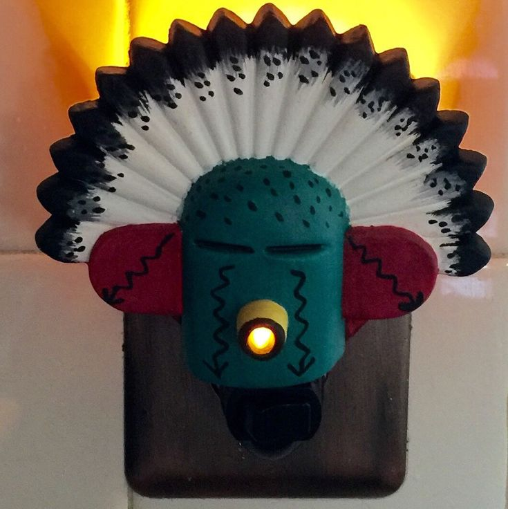 My handmade and painted Kachina mask  Southwestern night light. You can ask to have one painted in special colors or have it personalized if you'd like.