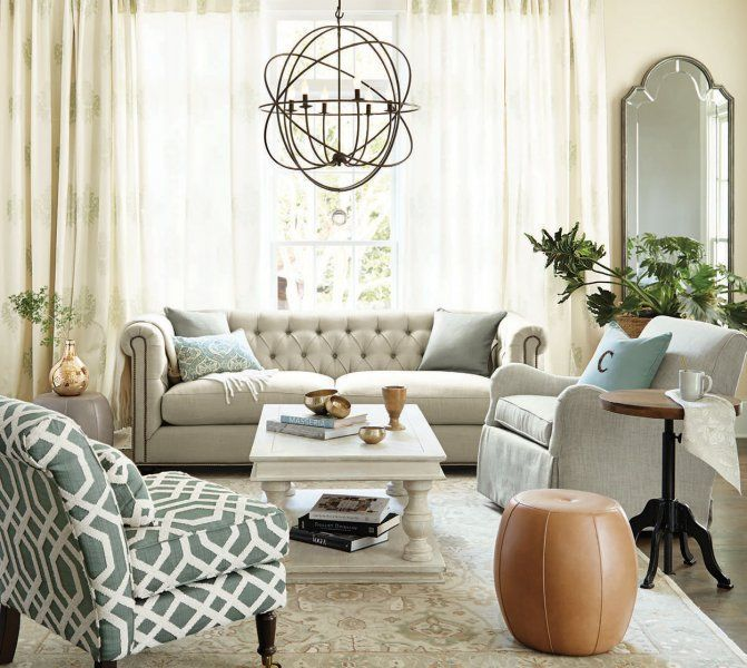 A large orb chandelier gives this living room a glam look, plus beautiful ambient lighting.