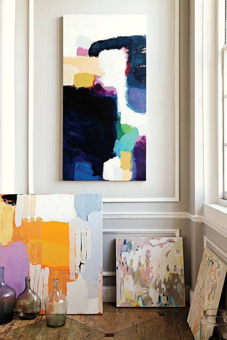 My paintings (the two larger ones... On the left, and hanging on the wall), as well as Michelle Armas paintings (the 2 smaller ones on the floor to the right): this is the photo they use in the Anthropologie catalog, this season!
