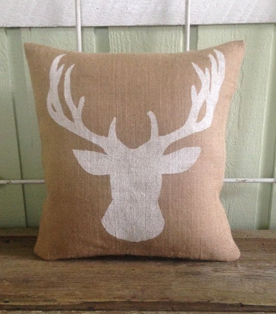 Handmade burlap pillow with a deer bust. Perfect for any house and can even double as holiday decor:) Hand painted white on natural burlap.
