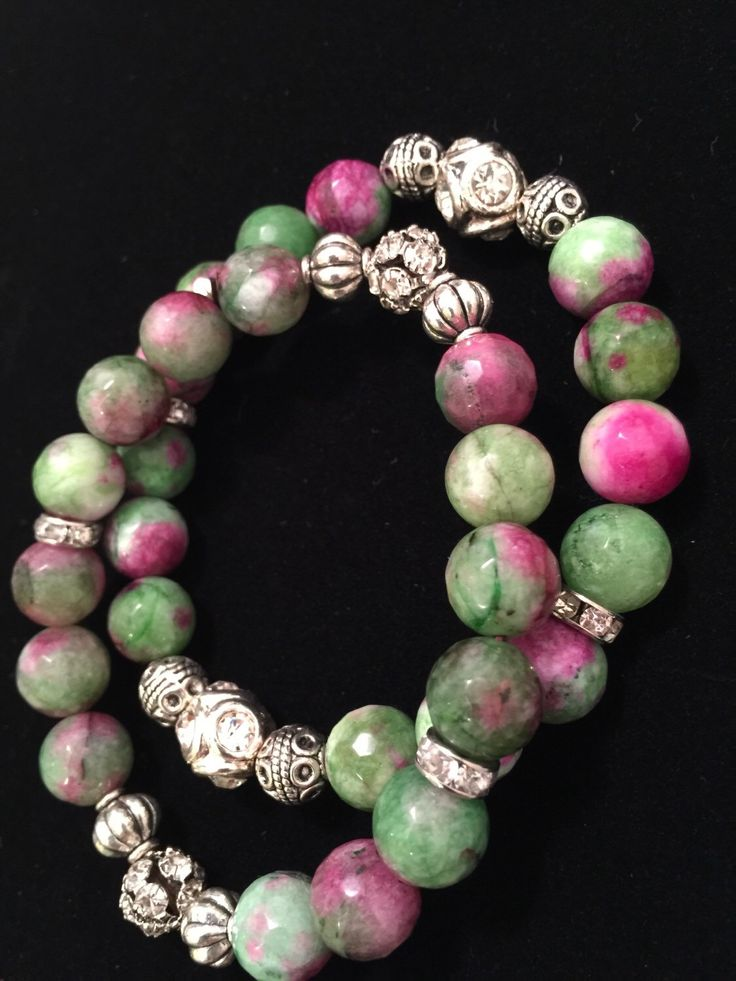 A Set of Faceted Ruby Zoisite (9 mm) Semi-Precious Stone  Stretch Bracelet with Crystal Silver Beads - 2 Bracelets by DicatoLuckyStone on Etsy https://www.etsy.com/listing/221694488/a-set-of-faceted-ruby-zoisite-9-mm-semi