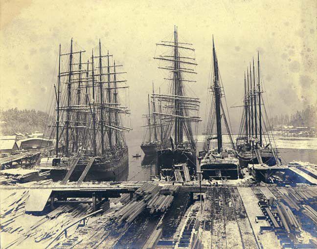 Ships loading lumber on the wharves of the Port Blakely lumber mill, Washington, 1905.